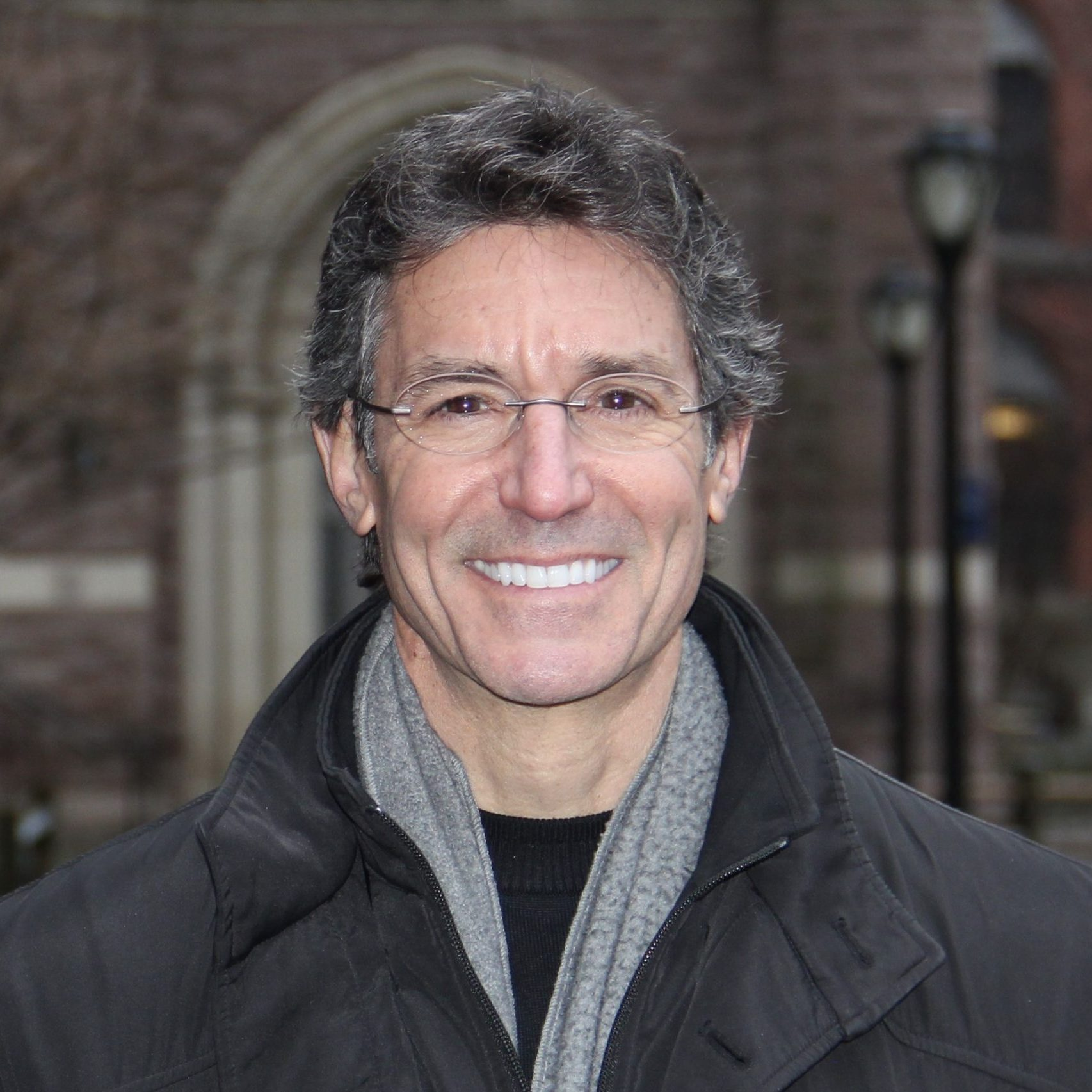 David L Katz MD in winter coat and scarf in front of Yale University building January 2020