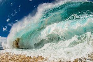 Big wave crashing on to a beach