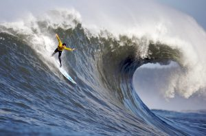 Surfer catching a huge wave