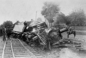 Black and White image of a derailed steam locamotive train
