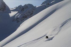 Skier skiing a black diamond steep slope