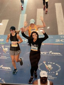 The author's daughter, crossing the NYC Marathon finish line in 2019