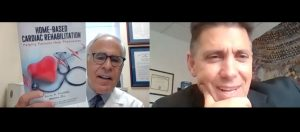 Barry Franklin PhD on left holds up his booklet, Home-Based Cardiac Rehabilitation, during Zoom interview with Tom Rifai, MD at right