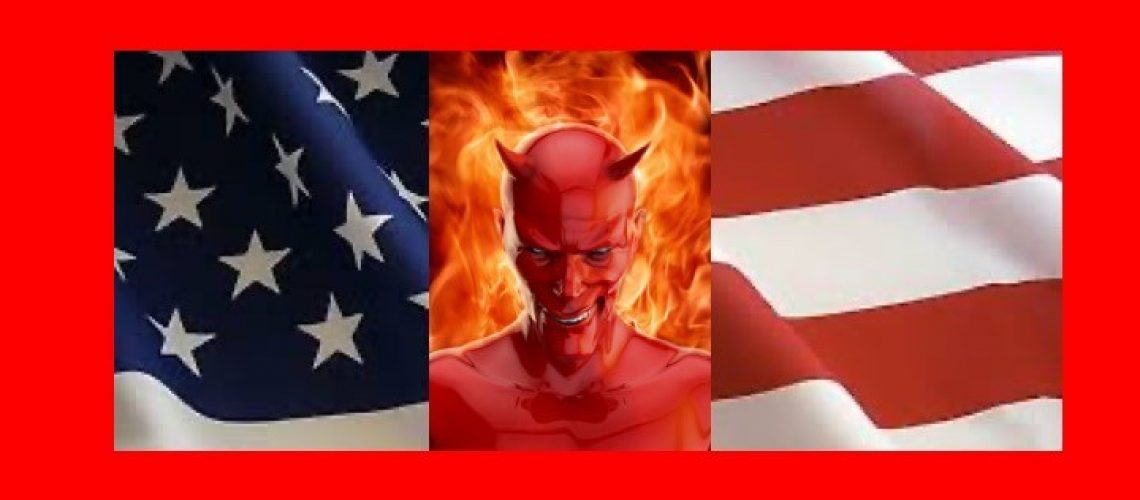Devil with an evil smile on fire in front of a US flag