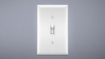 Light switch on gray wall. Switch is